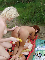 Perky tits lesbians fingering pussy at the nude beach