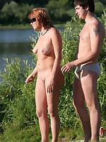 Nudists having fun at the lake