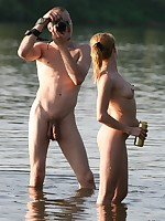 Nude Beach. Wild couple making a nude beach video